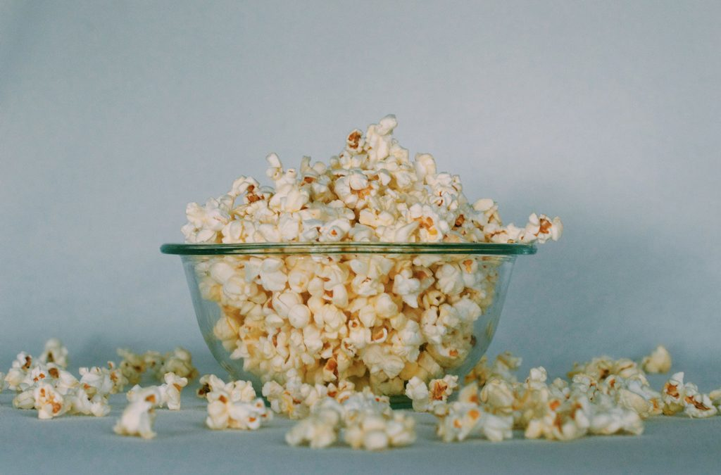 How to Host a Cheesy Holiday Movie Watching Party